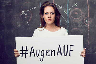 "Felicitas Woll holding a sign that says ""#AugenAUF"" (eyes open) (Photo)"